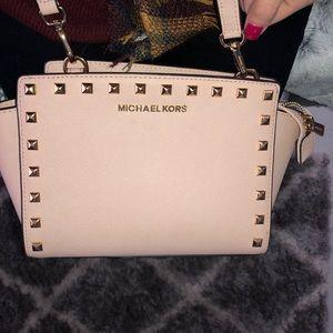 Blush MK crossbody purse with gold studs